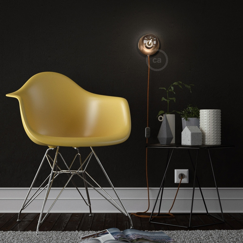 Spostaluce, the coppered metal light source with fabric cable and side holes