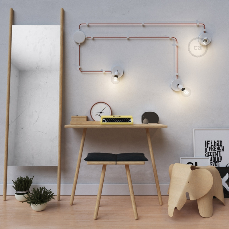 Spostaluce Metallo 90°, the white adjustable light source with fabric cable and side holes